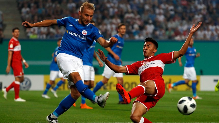 Mandatory Credit: Photo by FELIPE TRUEBA/EPA-EFE/REX/Shutterstock (9793767d) Stefan Wannenwetsch (L) of Rostock and Daniel Didavi of Stuttgart in action during the German DFB Cup first round soccer match between Hansa Rostock and VfB Stuttgart in Rostock, Germany, 18 August 2018. (ATTENTION: The DFB prohibits the utilisation and publication of sequential pictures on the internet and other online media during the match (including half-time). ATTENTION: BLOCKING PERIOD! The DFB permits the further utilisation and publication of the pictures for mobile services (especially MMS) and for DVB-H and DMB only after the end of the match.) Hansa Rostock vs VfB Stuttgart, Germany - 18 Aug 2018