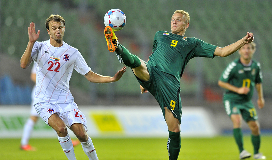 Lars Gerson (L) of Luxembourg fights the ball with Deivydas Matulevicius (R) of Lithuania during their friendly game at Josy Barthel Stadium, Luxembourg, 14 August 2013. © Photo/Nicolas Bouvy