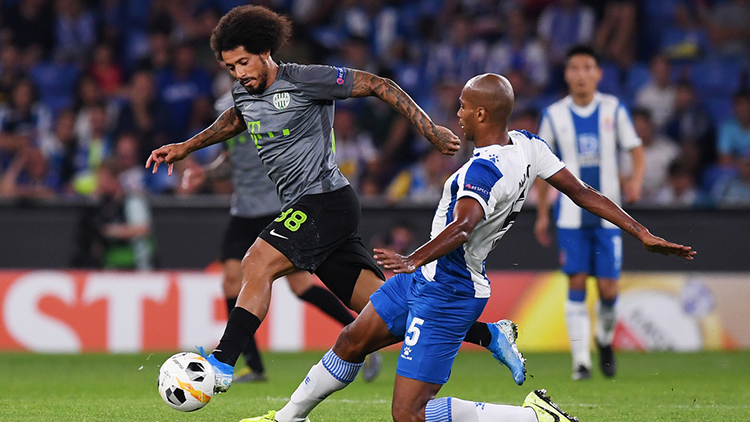 BARCELONA, SPAIN - SEPTEMBER 19: Naldo of Espanyol and Isael of Ferencva compete for the ball during the UEFA Europa League group H match between Espanyol Barcelona and Ferencvarosi TC at Power8 Stadium on September 19, 2019 in Barcelona, Spain. (Photo by Alex Caparros/Getty Images)