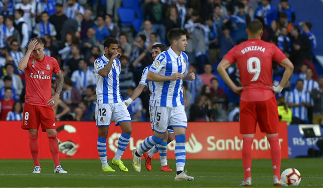Real Sociedad's players celebrate after scoring a goal during the Spanish League football match between Real Sociedad and Real Madrid at the Anoeta Stadium in San Sebastian on May 12, 2019. (Photo by ANDER GILLENEA / AFP) (Photo credit should read ANDER GILLENEA/AFP/Getty Images)
