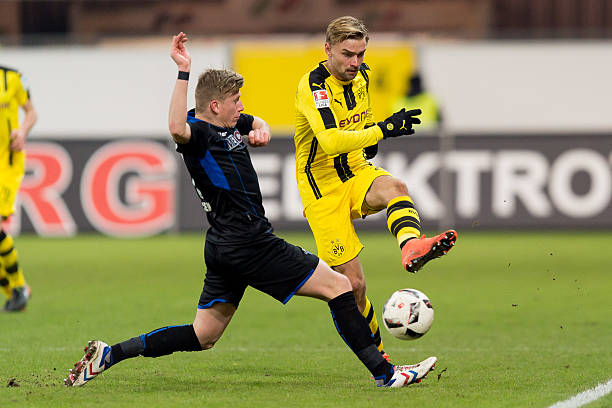 PADERBORN, GERMANY - JANUARY 17: Marcus Piossek of SC Paderborn and Marcel Schmelzer of Dortmund battle for the ball during the friendly match between Borussia Dortmund and SC Paderborn at the Benteler-Arena on January 17, 2017 in Paderborn, Germany. (Photo by TF-Images/Getty Images)