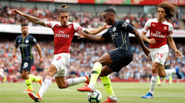 """Soccer Football - Premier League - Arsenal v Manchester City - Emirates Stadium, London, Britain - August 12, 2018 Arsenal's Hector Bellerin in action with Manchester City's Raheem Sterling Action Images via Reuters/John Sibley EDITORIAL USE ONLY. No use with unauthorized audio, video, data, fixture lists, club/league logos or """"live"""" services. Online in-match use limited to 75 images, no video emulation. No use in betting, games or single club/league/player publications. Please contact your account representative for further details."""