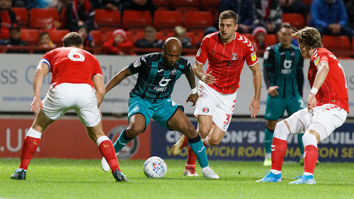 LONDON, ENGLAND - AUGUST 31: Andre Ayew of Swansea City City (2nd L) in action during the Sky Bet Championship match between Charlton Athletic and Swansea City at The Valley on October 02, 2019 in London, England. (Photo by Athena Pictures/Getty Images)