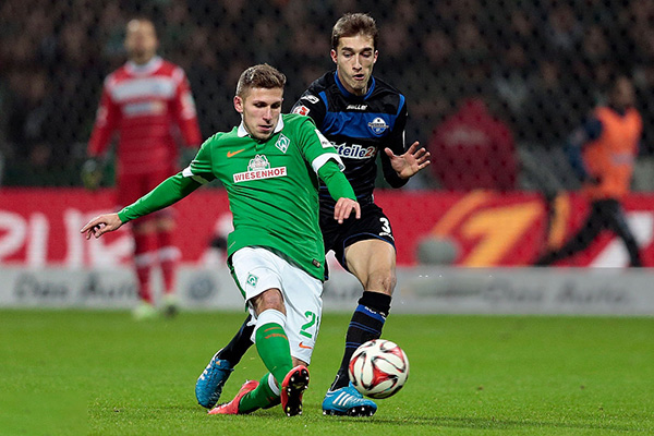 BREMEN, GERMANY - NOVEMBER 29: Levent Aycicek (L) of Bremen and Rafael Lopez Gomez (R) of Paderborn compete for the ball during the First Bundesliga match between SV Werder Bremen and SC Paderborn 07 at Weserstadion on November 29, 2014 in Bremen, Germany. (Photo by Oliver Hardt/Getty Images)