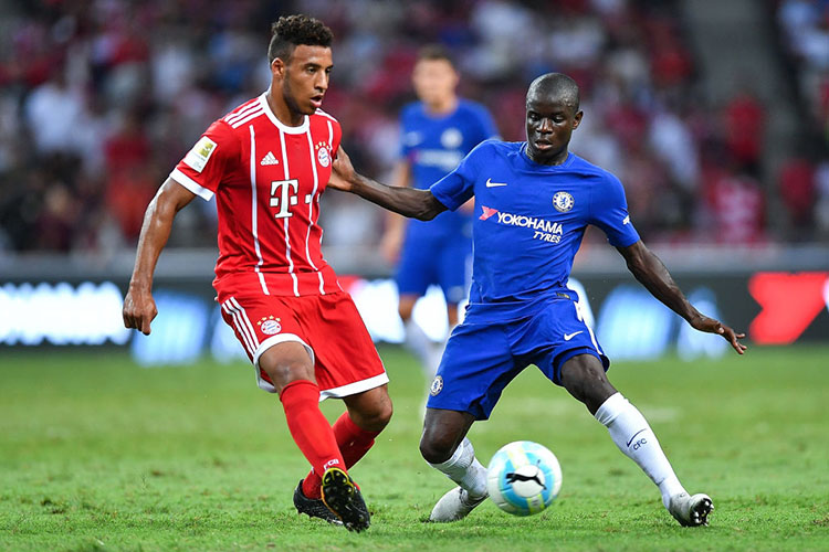 SINGAPORE - JULY 25: Corentin Tolisso #24 of FC Bayern Muenchen and N'Golo Kante #7 of Chelsea FC competes for the ball during the International Champions Cup match between Chelsea FC and FC Bayern Munich at National Stadium on July 25, 2017 in Singapore. (Photo by Thananuwat Srirasant/Getty Images for ICC)
